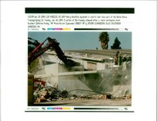 The 1994 Northridge earthquake USA:heavy demolition vequipment is used to tear down.
