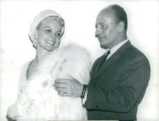 Carroll Baker with a man holding her  shoulder.