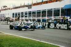 Racers driving their cars during a Formula one race.