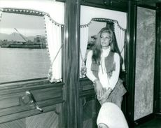 Dalida pictured standing beside a window.
