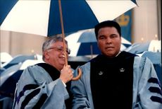 Muhammad Ali, who suffers from Parkinson's disease, remained stuck in the rain when he was appointed honors doctor at Columbia University.