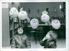 Two children Stephen Farrell and Timothy Elston siting at the Luton's Children Library.
