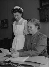 Attorney General Ingrid Stenbeck instructs a young assistant sister - 18 June 1944