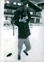 American actor and singer Jack Palance having fun with his son and smiling.
