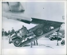 A M- 34 two and half ton truck, a key item for forward supply operations, move easily up the ramp to Boeing c -97 Stratofrieghter.