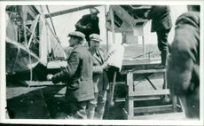 mechanics and lt brown preparing the vimy aircraft for its atlantic flight.