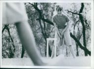 Woman standing and playing at park.