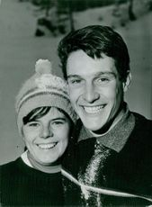 Annie Famose and Georges Mauduit smiling on camera. Photo taken Dec 30,1960