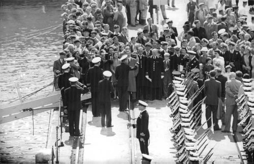 Officers greeting sailors.