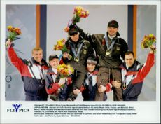 German and American rodel boys celebrate their medals from rodel dublin during the Winter Olympics in 1998