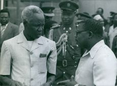 President Julius Nyerere of Tanzania with his Minister for Foreign Affairs. Benjamin Mkapa (right) at Dar-as-Salaam airport, 1980.