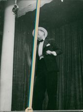 Maurice Chevalier performing.