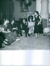 Marie Thérèse, Duchess of Württemberg and Henri d'Orléans, Count of Clermont at a party.