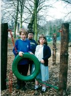 Jonathan, back, Michael and Nicola with the tire swing at The Hall School.