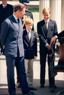 Prince Charles together with the sons of Prince William and Prince Harry