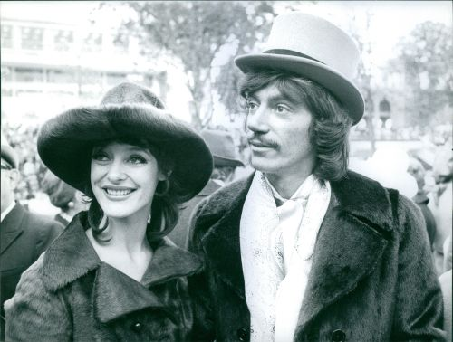 An upclose photo of a smiling man and woman.