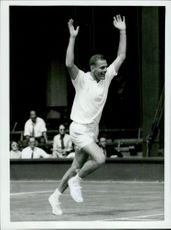 Ulf Schmidt runs smoothly against the net after defeating Bobby Wilson in the Eurozone in the Davis Cup