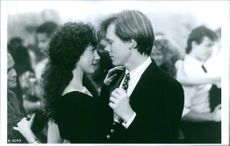 """Elizabeth Perkins and Kevin Bacon in a scene from a 1991 American romantic comedy film, """"He Said, She Said."""""""