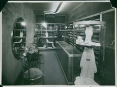 """Illuminated cloth shop in a department store.  """"Centre department store"""""""