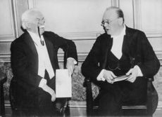Winston Churchill in a meeting with man.