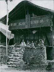 Group of children relaxing on porch.