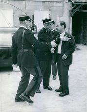 A man stop by the guards.1964