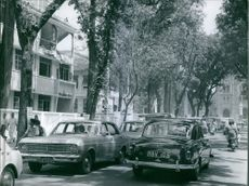 A vintage photo of a building at left were bombarded during Vietnam war.