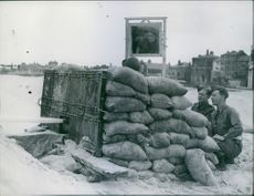 Powerful Jet being operated from a Sand Bagged pit in which the operator sits as protection during the cleaning of mines from the Yarmouth Beach.