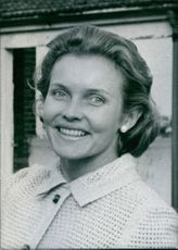Ann Frances Darlow looking at something and smiling.