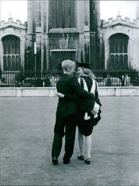 A couple in front of a church.