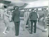 Queen Juliana of the Netherlands at an airport.