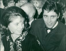 Sacha Distel with his wife.