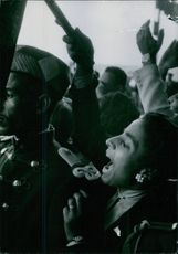 People screaming during a protest.
