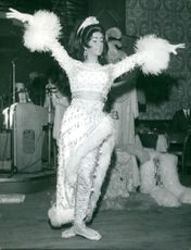 A woman wearing a fancy outfit as she performs a dance number.  Taken - 10 Mar. 1970