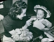 Woman spending time with her child, another member of the Ruspoli family. Photo taken on ,1962.