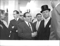 "Robert Francis ""Bobby"" Kennedy indulged in a conversation wearing a round hat."