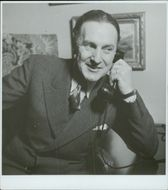Norwegian personality, Leif Amble-Næss, is seen talking on the telephone. 1941.