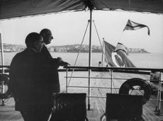 Charles André Joseph Marie de Gaulle on boat.
