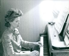Gersende Thérèse de Sabran-Pontèves, wife of Prince Jacques of Orléans, Fils de France, Duke of Orleans, playing a piano.