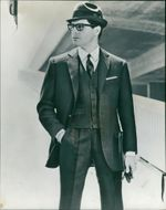 Fashions: single breasted swiss business suit.