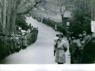 A view of a street filled with military people during the tour of the royal couple, Prince Philip and Elizabeth II.