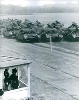 England Army troops with tanks in formation and soldiers saluting.