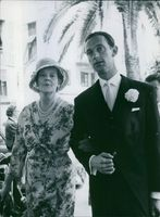Prince Xavier with a woman, looking towards the camera and smiling. 1960