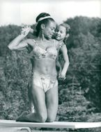 Eartha Kitt plays with her daughter by the pool