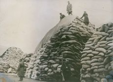 Food store of the Austro-Hungarian army in the East: Russian POW's covering sacks of flour, World War I on the Eastern Front.