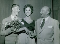 A beautiful lady with two gentlemen.