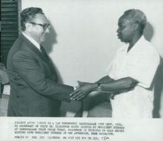 Henry Kissinger is welcomed by Tanzania's President Julius Nyerere at Dar es Salaam City Hall