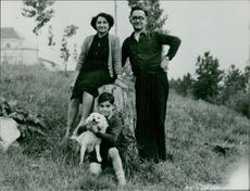 A family photograph of Yves Saint-Martin with his dog.