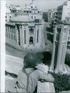 Soldier on the building while holding gun and targeting in Lebanon, 1958.