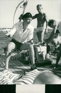 Yves Montand aboard a yacht during his vacation at the French Riviera